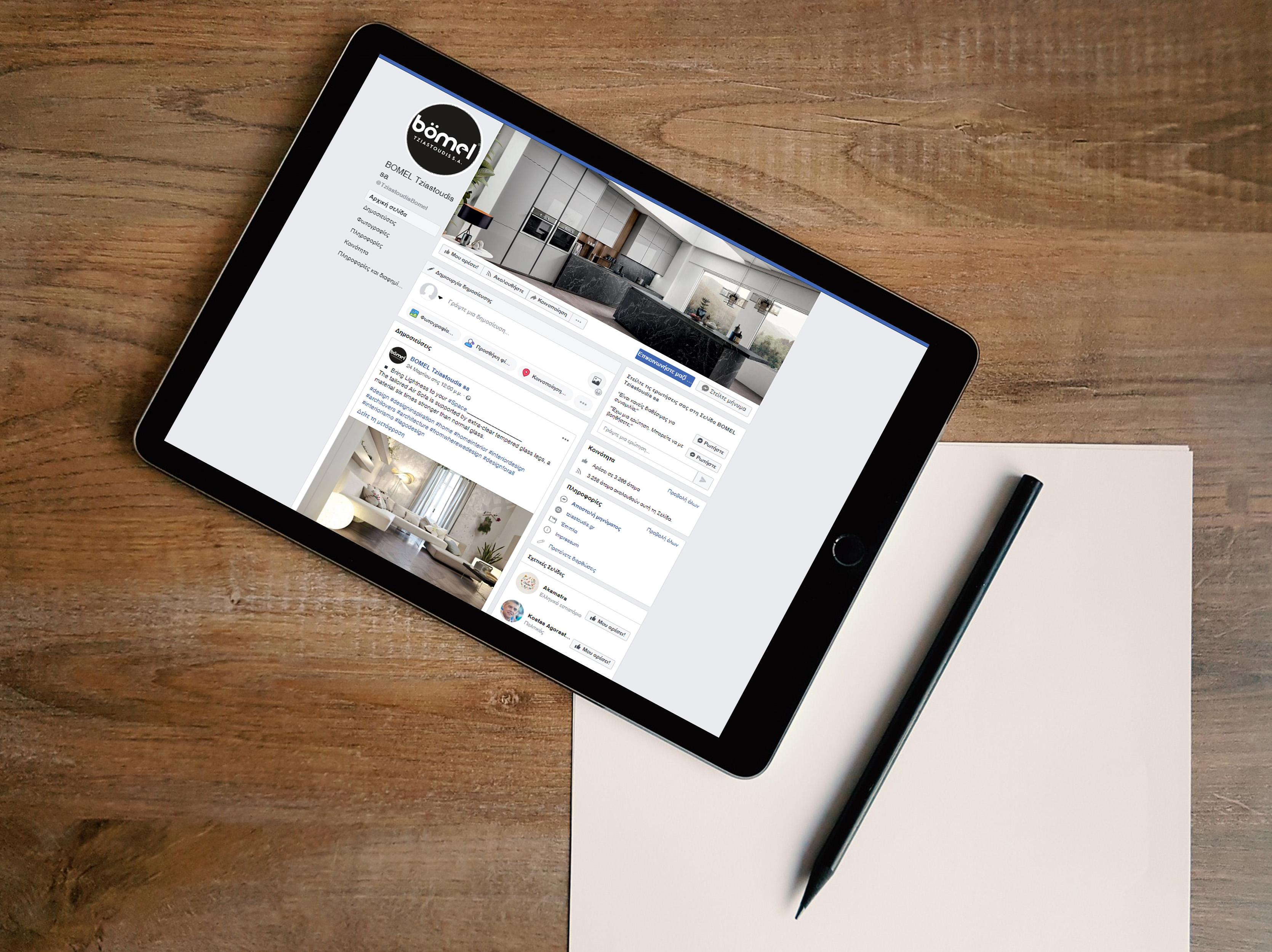 bomel_fb-tablet-on-wooden-desk-mock-up